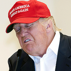 "Donald Trump wearing ""Make America Great Again"" cap, making a face expressing disgust"