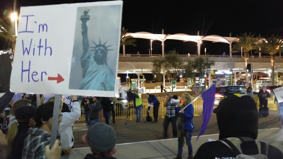 """I'm With Her"" poster sign depicting Lady Liberty at Indivisible protest rally at Lindbergh Field airport"