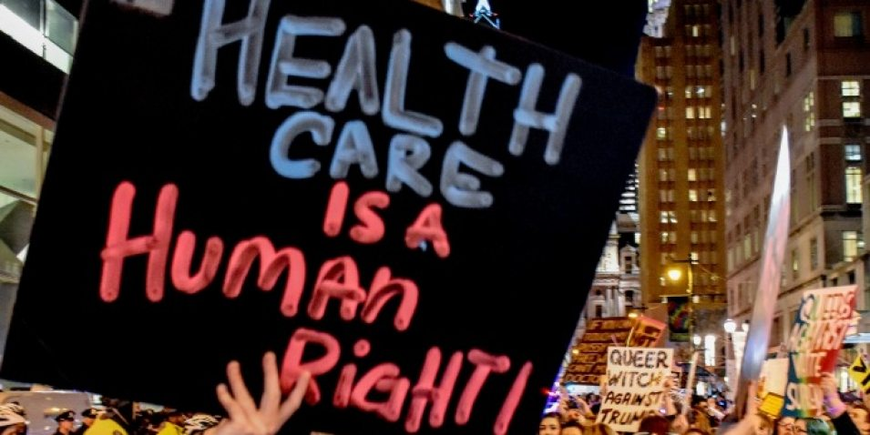 """Health care is a human right!"" protest sign Medicare-for-All"