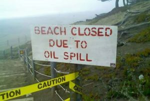 Sign: Beach closed due to oil spill