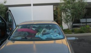 View of rear window of car with personal belongings