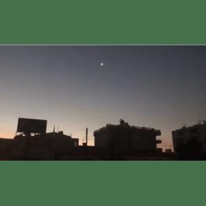 Silhouette of buildings against night sky