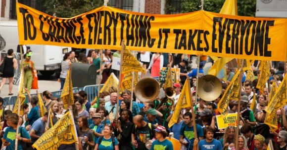 Climate march crowd carrying banners
