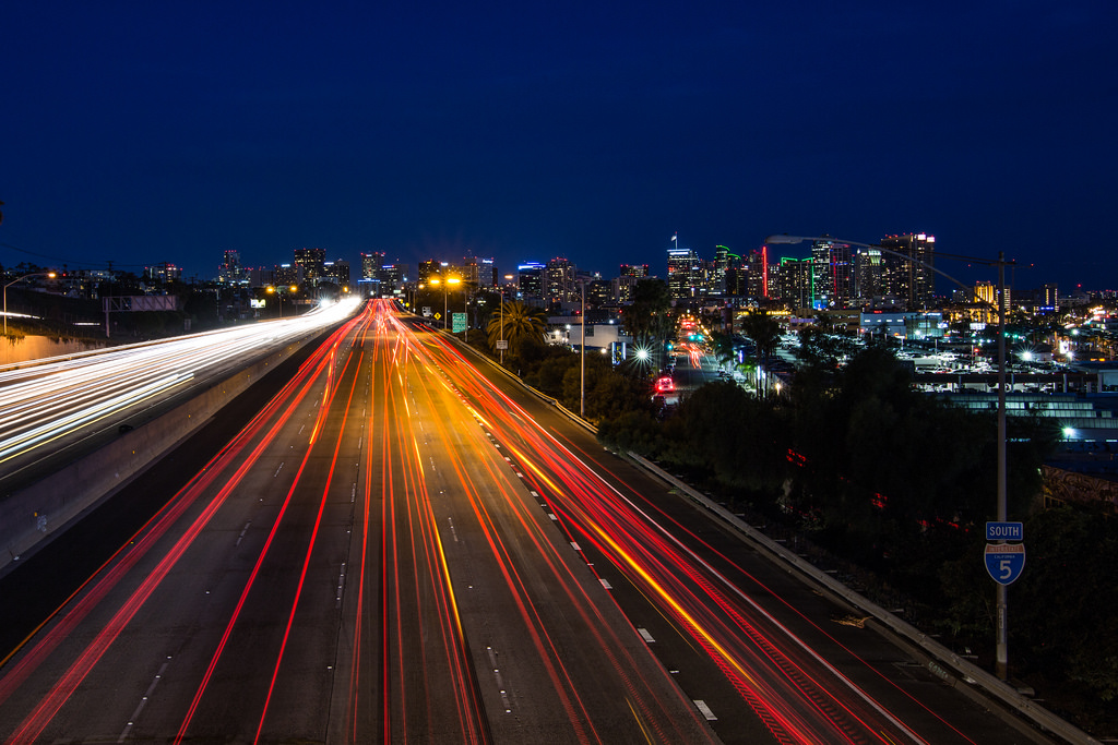 Night time freeway, long exposure setting to show headlights and tail lights as streaks