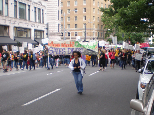 """Protest marchers carrying banner reading """"Whose schools? Our Schools! / Gates Divest"""""""