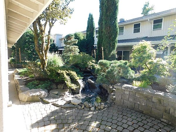 Walkway with shrubbery landscaping