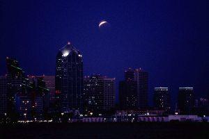Lunar eclipse over downtown San Diego skyline