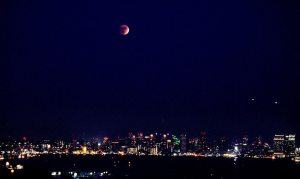 Lunar eclipse over downtown San Diego skyline