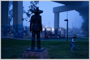Twilight time view from behind of statue of Zapata in Chicano Park
