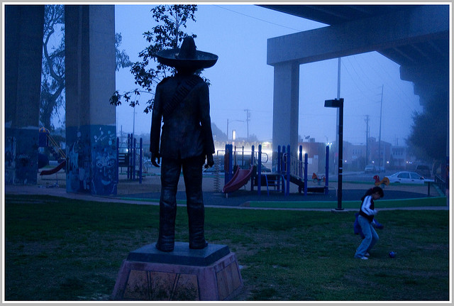 Twilight time view from behind of the statue of Zapata in Chicano Park