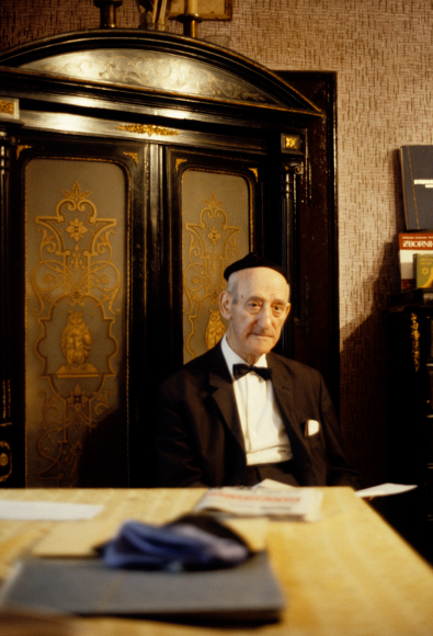 Rabbi seated behind table
