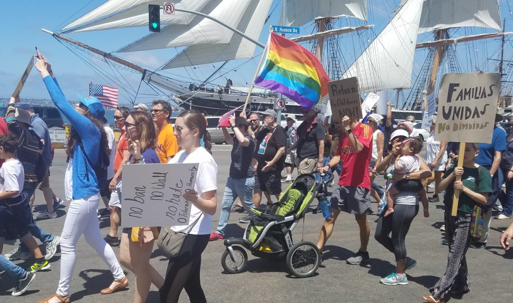 'Families Belong Together' rally marchers with signs