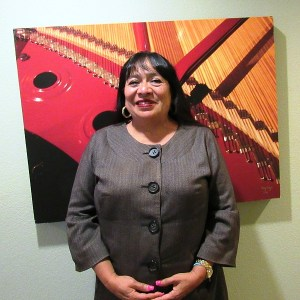 Woman standing in front of wall art work