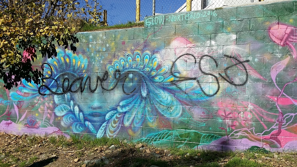 Concrete block wall with tagged mural