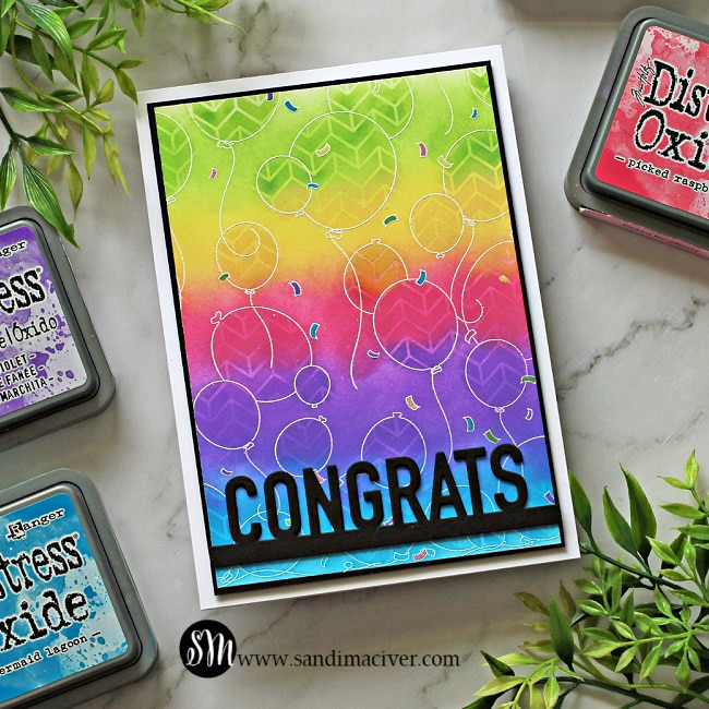 a handmade greeting card colored with distress oxide Inks  in a rainbow pattern and stamped with the Party Balloons stamp from Simon Says Stamp