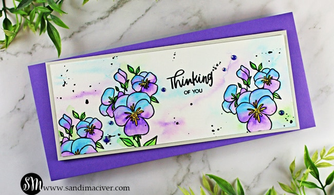hand made slimline card with pansies stamped from Ellen Hutson LLC