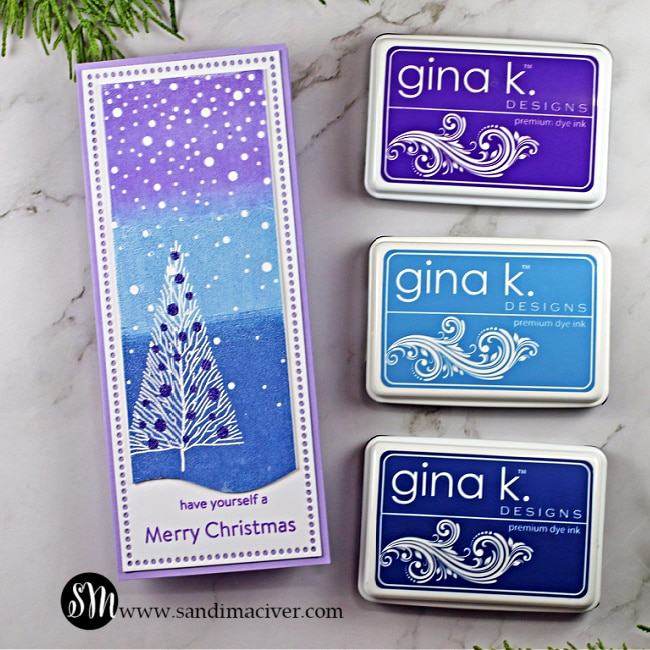 handmade slimline christmas card with a purple and blue blended ink background using products from SImon Says Stamp