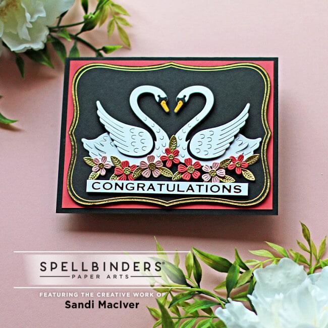handmade card with two die cut swans and flowers using dies from Spellbinders