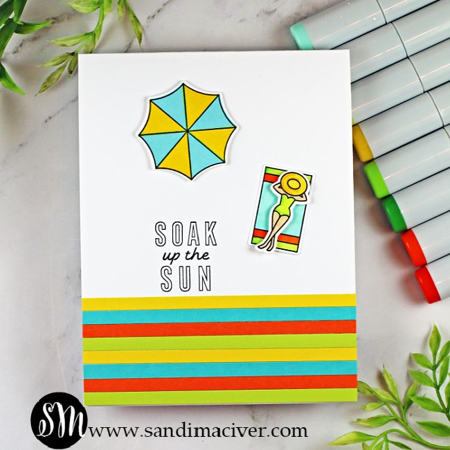 handmade card with a sunbather and umbrellas created with new cardmaking supplies from Ellen Hutson