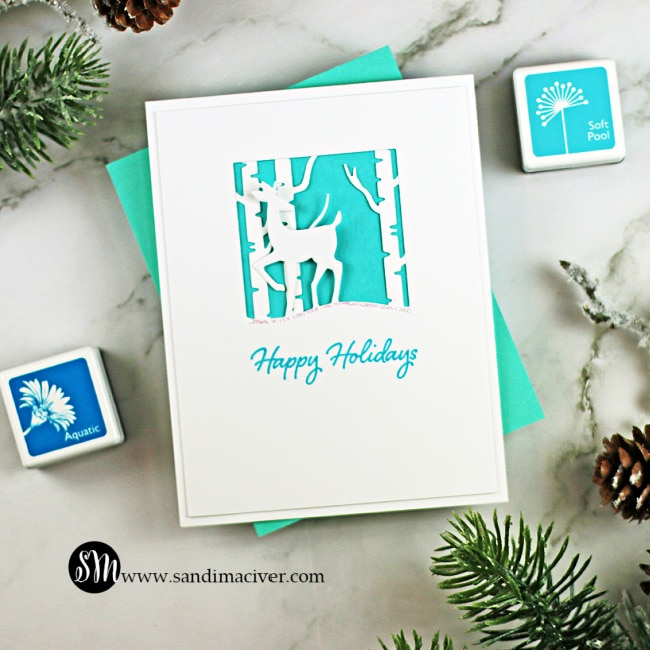 handmade blue and white card with a silhouette deer created with new die cutting paper crafting tools from Hero Arts