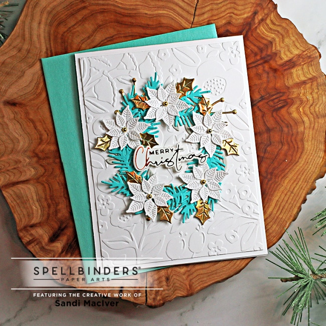 white blue and gold handmade christmas card using cardmaking and paper crafting dies and glimmer plates from Spellbinders