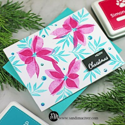 handmade christmas card with pink poinsettias and blue leaves using new paper crafting products from Simon Says Stamp