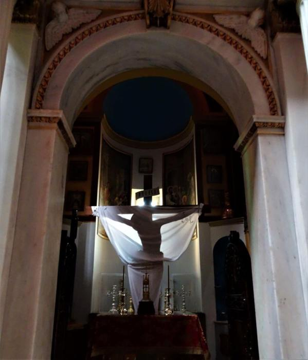 Shadow of Jesus on a cross in a church. Syros, Greece