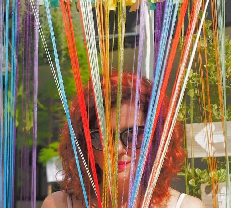 me peaking through colored string-you know your an expat when