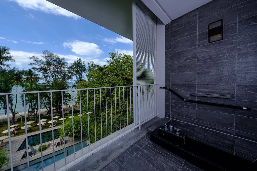 Balcony with view of pool and ocean-Lone Pine Hotel