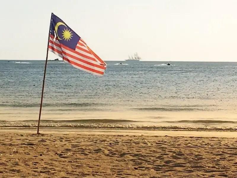 Malaysian flag on the beach