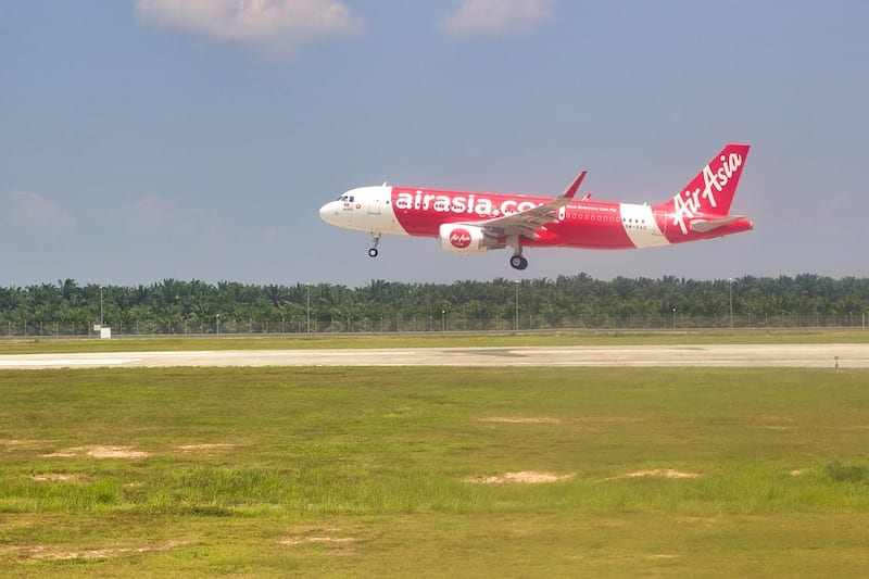 red Air Asia plane landing- dos and don't in Malaysia