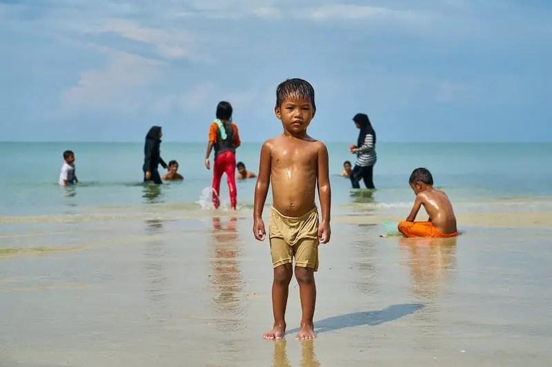 people on beach in Malaysia