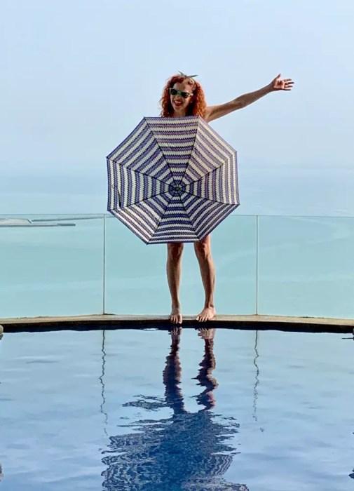 me with umbrella on edge of pool: improve quality of life