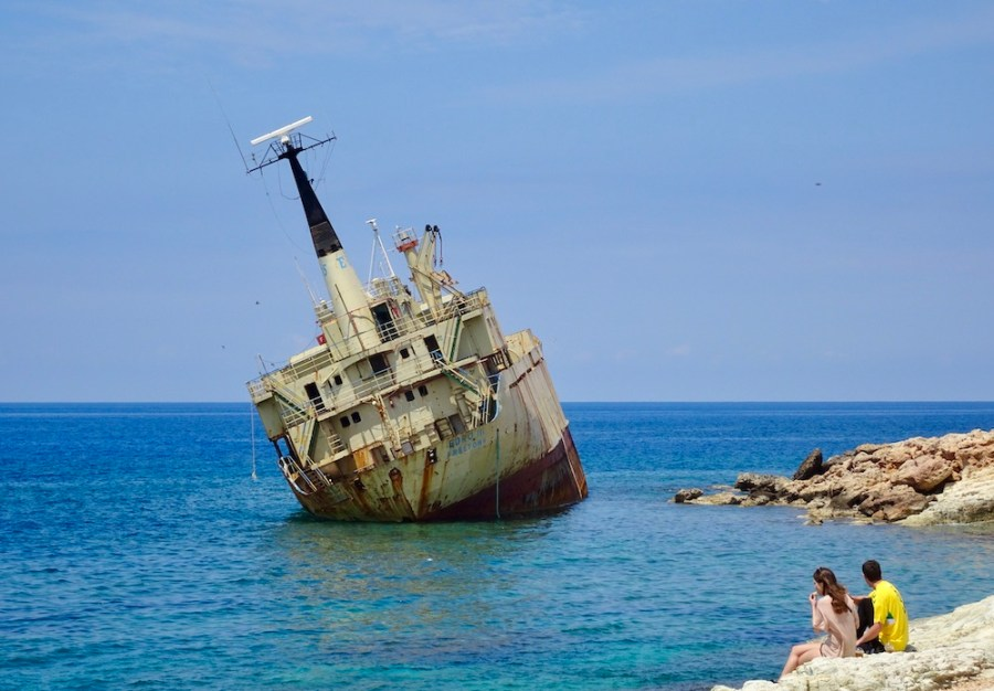 couple looking at a shipwreck