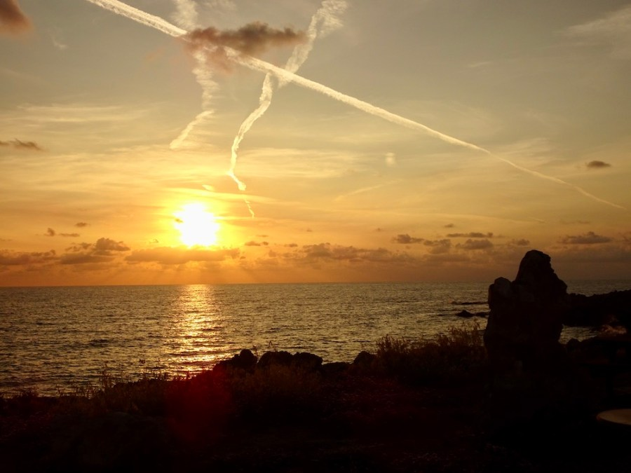 sunset with vapor trails