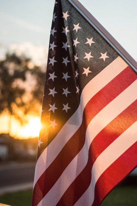 American flag with sunset