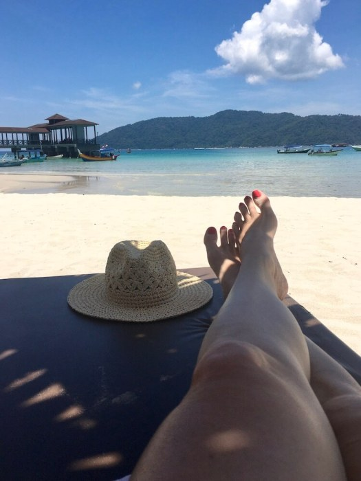 legs and hat on sun lounger: short getaway in malaysia