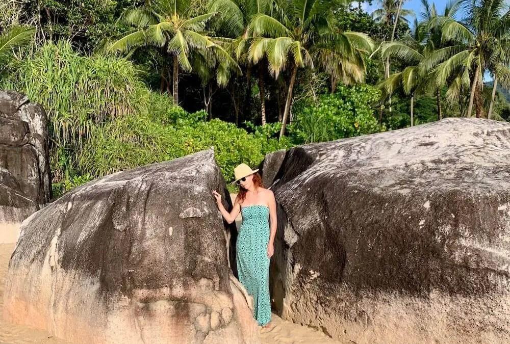 girl in turquoise dress between boulders