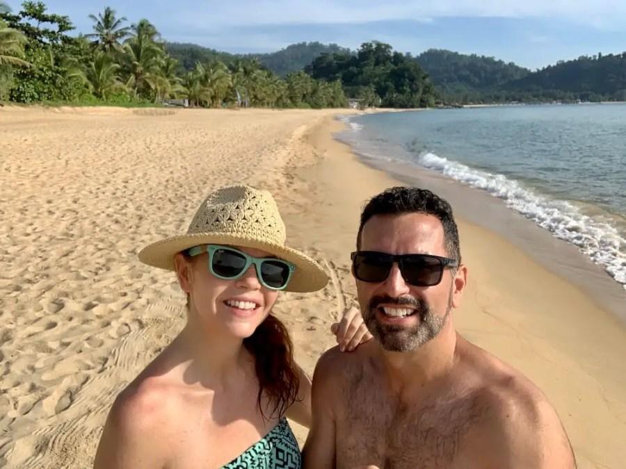 couple on deserted beach, tioman island