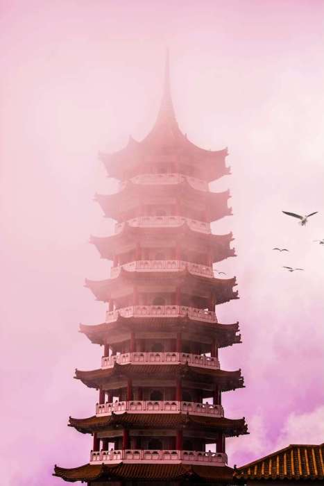 Chinese temple tower with pink skies