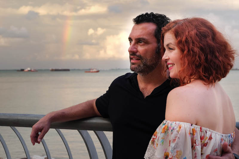 us looking out to side with rainbow in background