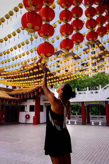 girl looking at red Chinese lanterns living in penang pros and cons