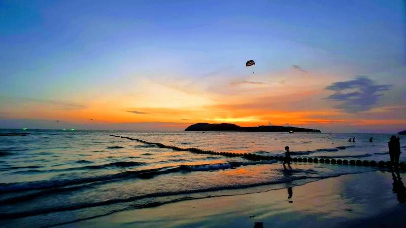 orange and blue sunset in Langkawi with parasail
