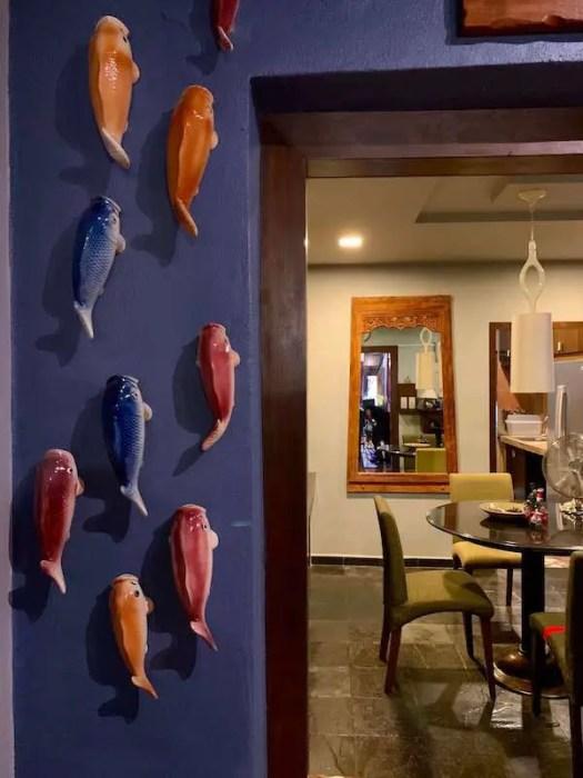 ceramic koi swimming up the wall