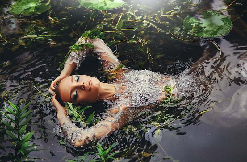 beautiful woman floating in river: Malaysian Legends
