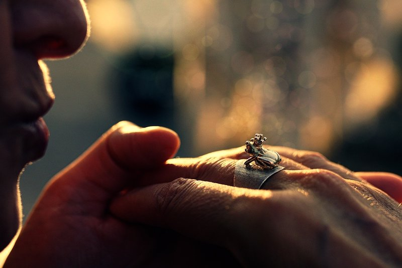 man kissing hand