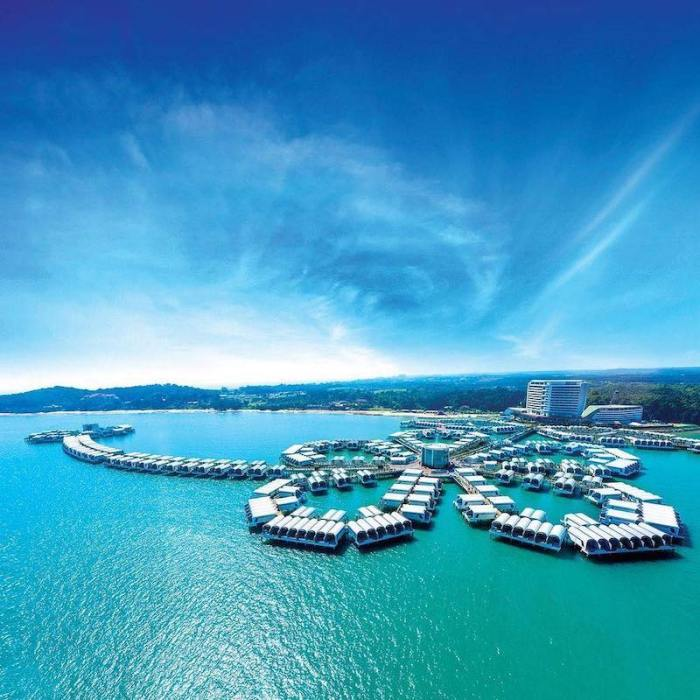 overwater bungalows shaped in a hibiscus