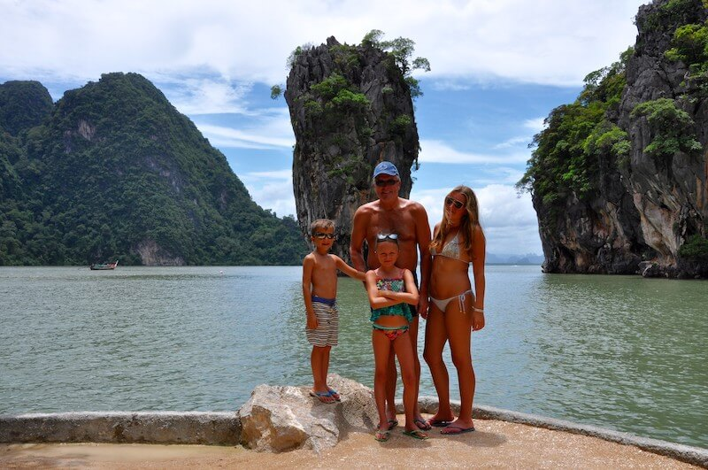 family in front of rocky outcrops in thailand