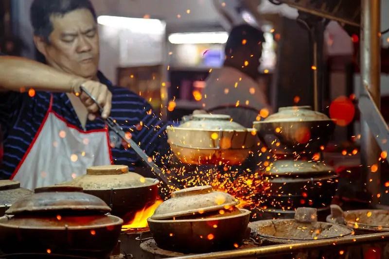 man cooking in malaysia