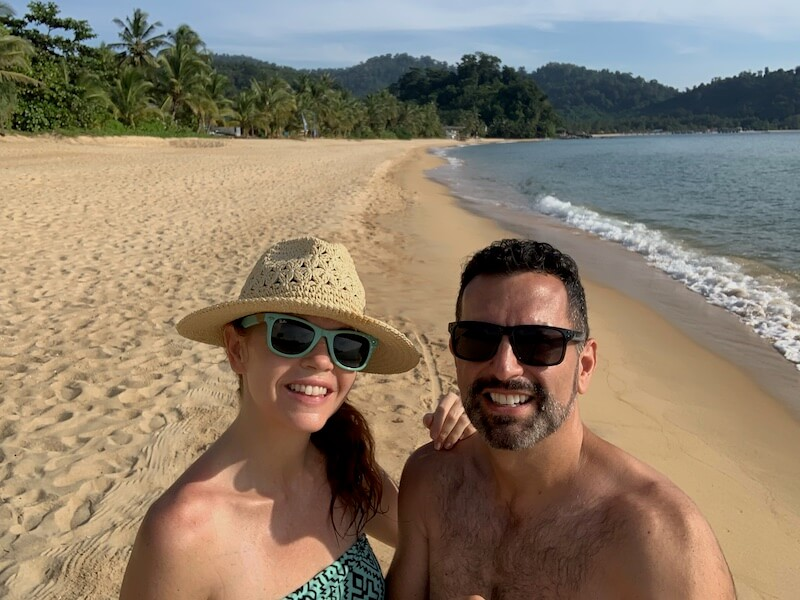 couple who live in Malaysia on a long deserted beach in Tioman.